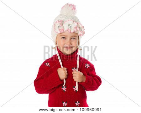Little Girl With Ponytails In A Warm Hat And Red Sweater  On A White Background