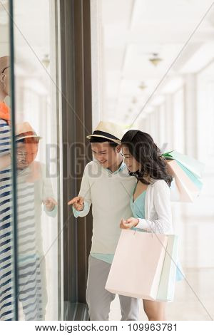 Couple at shop window