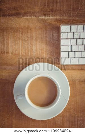 Above view of business desk with coffee cup and keyboard