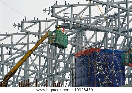 Group of construction workers standing in the mobile crane basket
