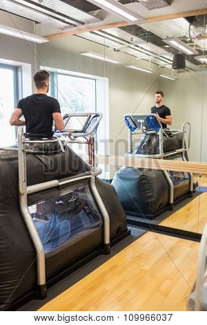Injured athlete working out on treadmill at the gym