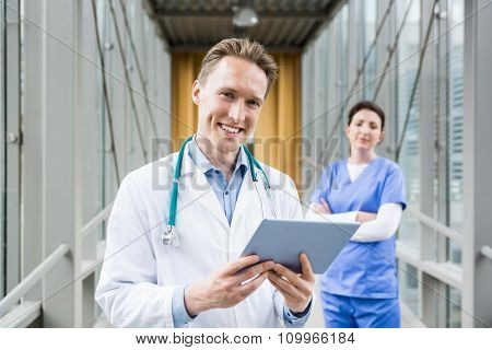 Doctor using his tablet pc at the hospital