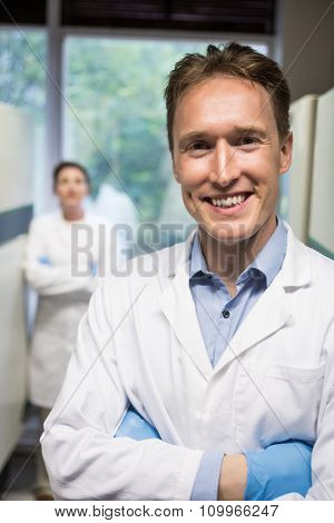 Two scientists smiling at camera in the lab