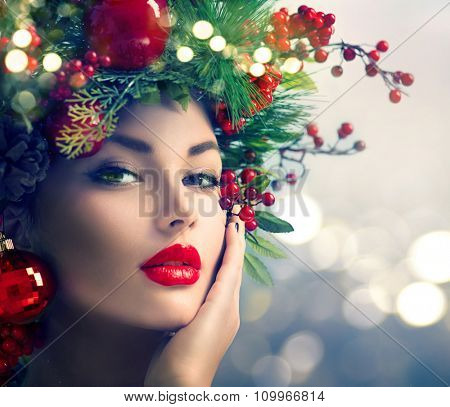 Christmas Makeup. Winter Fashion Woman. Beautiful New Year and Christmas Tree Holiday Hairstyle, Make up. Beauty Model Girl over glowing Background. Creative Hair style decorated with Baubles