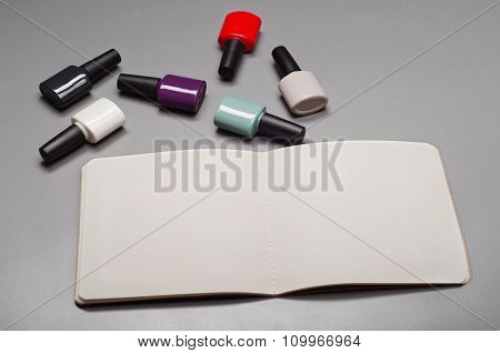Open Notebook With Blank Pages With Nail Polish
