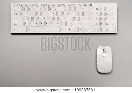 White Slim Keyboard With A White Slim Mouse