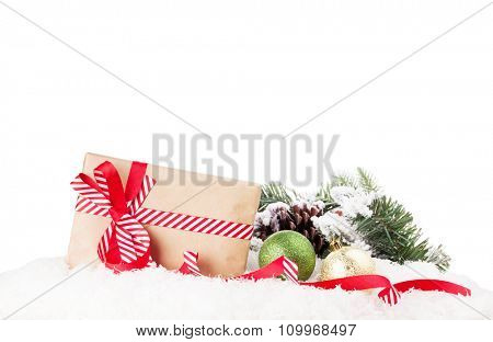 Christmas gift box and decor in snow. Isolated on white background