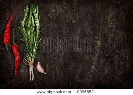 Herbs and spices over old wood table background with copy space