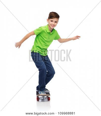 childhood, leisure, school and people concept - happy smiling boy with skateboard