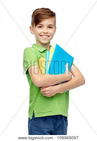 childhood, school, education and people concept - happy smiling student boy with folders and notebooks