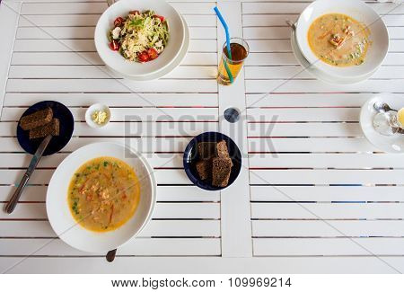 food, culinary, italian kitchen and eating concept - close up of pasta with tomato and cheese on plate at restaurant