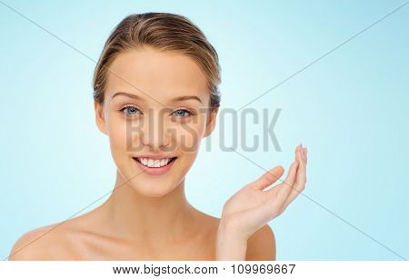 beauty, people and health concept - smiling young woman face and shoulders