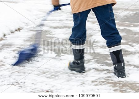 Pushing The Snow With Curved Snow Shovel