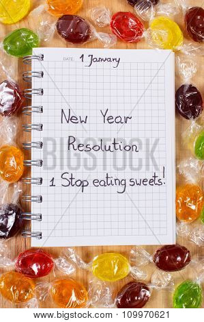 New Years Resolutions Written In Notebook And Colorful Candies