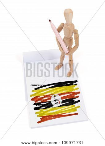 Wooden Mannequin Made A Drawing - Uganda