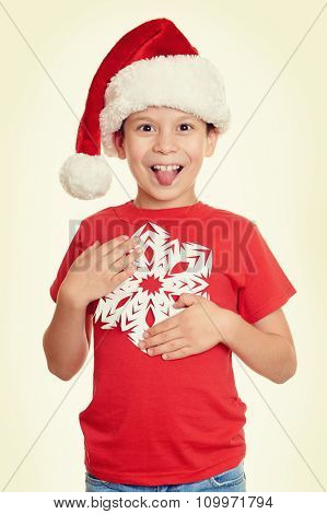 boy in santa hat portrait, yellow toned