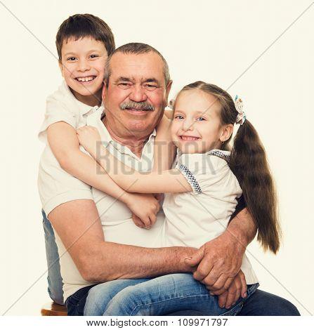 Grandfather and grandchildren portrait yellow toned