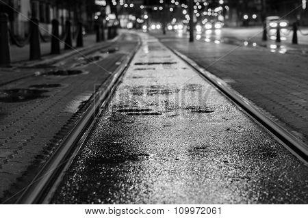 Night View On Wet Tram Rails After Rain