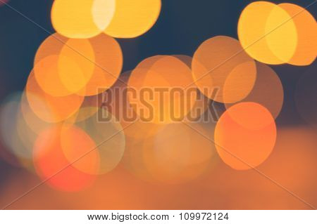 Abstract Background Of Orange Blurred Lights With Bokeh Effect
