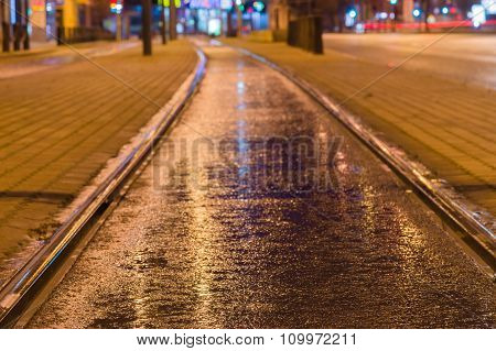 Tram Rail Track Wet And Shiny By Night Lights