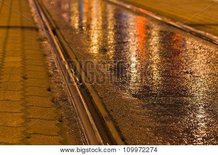 Closeup On Tram Rail By Night