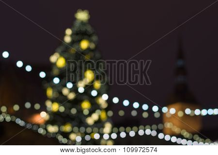 Abstract Blurred Background Of Decorated Christmas Fir On Central City Square