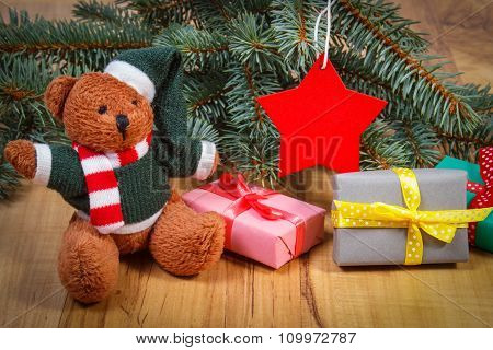 Teddy Bear With Gifts For Christmas, Spruce Branches And Red Star
