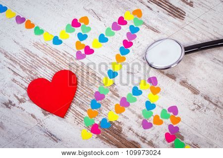 Cardiogram Line Of Paper Hearts And Stethoscope On Wooden Background, Medicine And Healthcare Concep