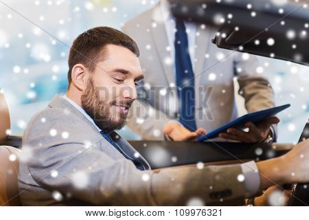 auto business, car sale, consumerism and people concept - happy man with car dealer in auto show or salon over snow effect