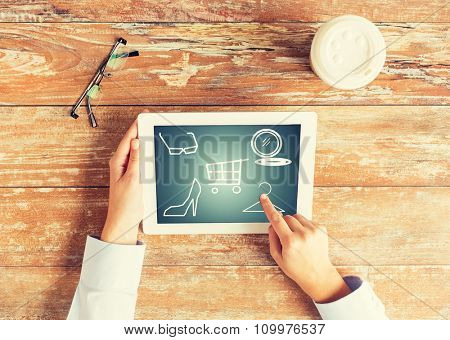 fashion, sale, people and technology concept - close up of female hands pointing finger to tablet pc computer with shopping icons on screen