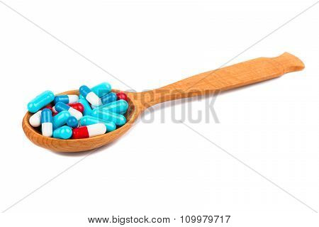 Capsules In The Spoon