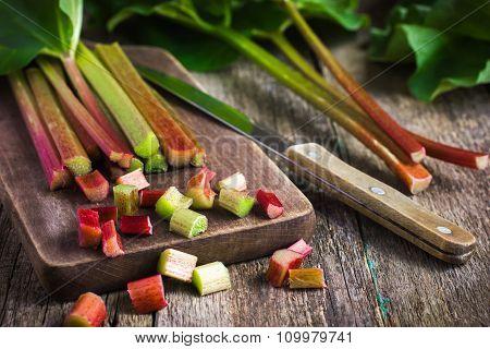 Fresh Organic Rhubarb On Wooden Background