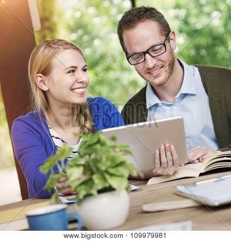 Couple Sharing Internet Searching Information Corporate Concept