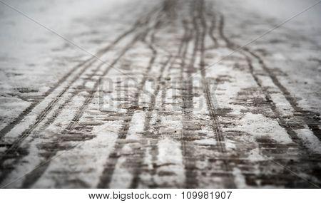 footprints on the snowy sidewalk