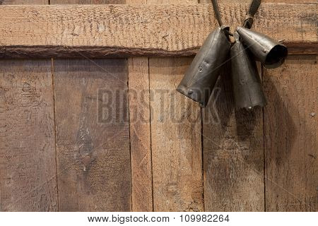 Pastoral Bells On Brown Wooden Background