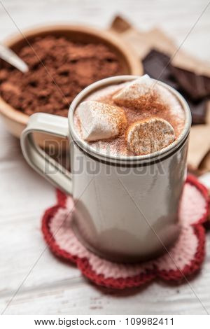 Cocoa drink with marshmallows and cinnamon