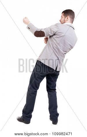 back view of standing man pulling a rope from the top or cling to something.  Rear view people collection.  backside view of person.  Isolated over white background.