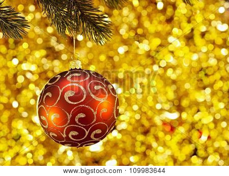 Close-up photo of red christmas ball hanging on christmas tree.