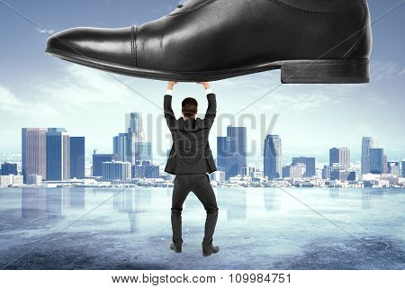 Business Pressure Concept With Businessman Under The Boot At City Background