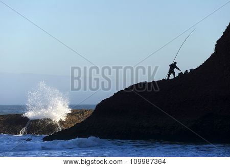 Fisherman at Legzira Beach, Morocco, Africa