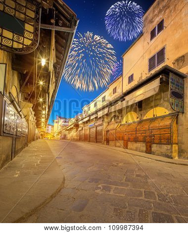 Beautiful fireworks above Arno River and Ponte Vecchio at sunset, Florence