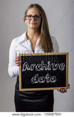 Archive Data - Young Businesswoman Holding Chalkboard With Text