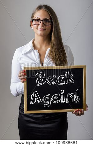 Back Again! - Young Businesswoman Holding Chalkboard With Text