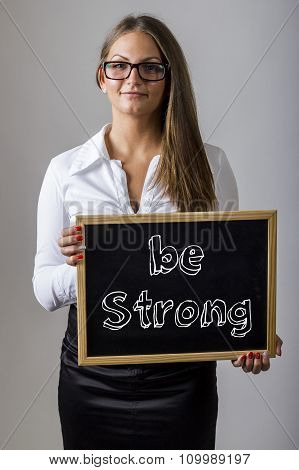 Be Strong - Young Businesswoman Holding Chalkboard With Text