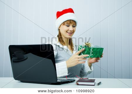 Working Girl In Santa Hat With A Gift