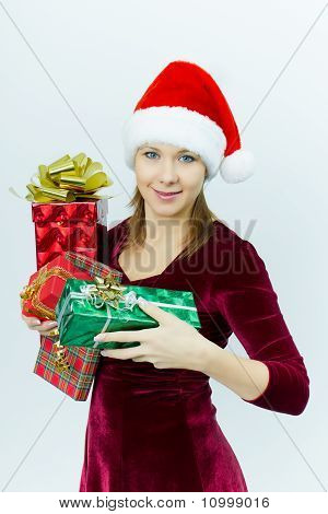 Beautiful Smiling Girl In Santa Hat With Presents