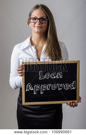 Loan Approved - Young Businesswoman Holding Chalkboard With Text