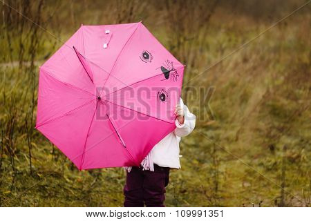 The Little Girl I Hid Under A Pink Umbrella In Autumn Park