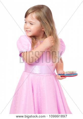 Little girl with hair brush