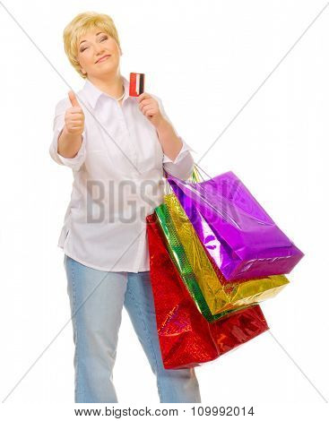 Happy senior woman with bags and credit card isolated